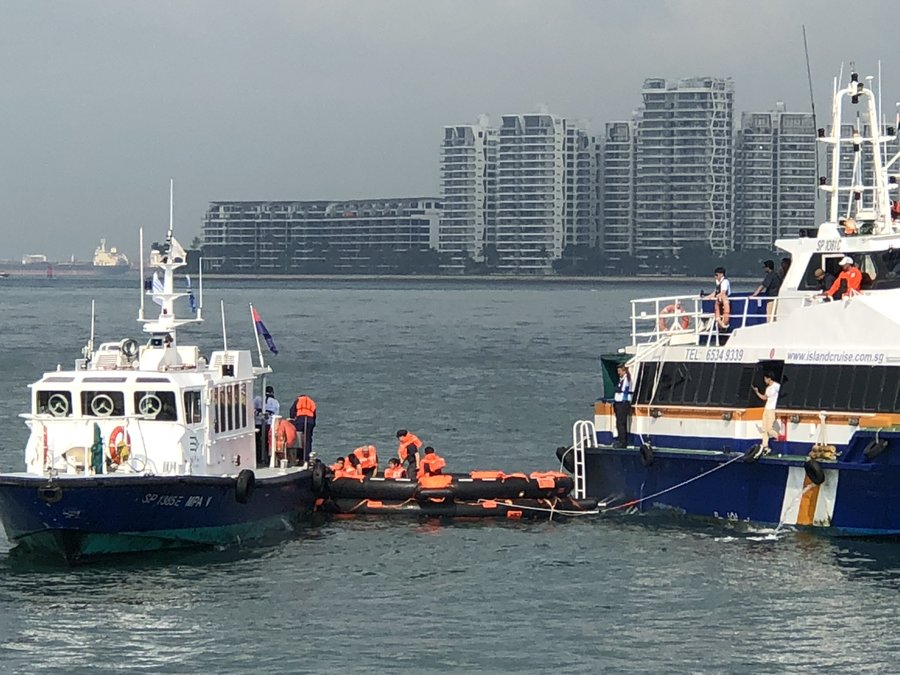 Transfer of passengers from liferaft to MPA rescue vessel